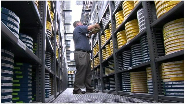 A man storing film canisters in the Academy Film Archive