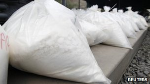 Bags containing cocaine are displayed during a drug incineration in Lima on April 18, 2013