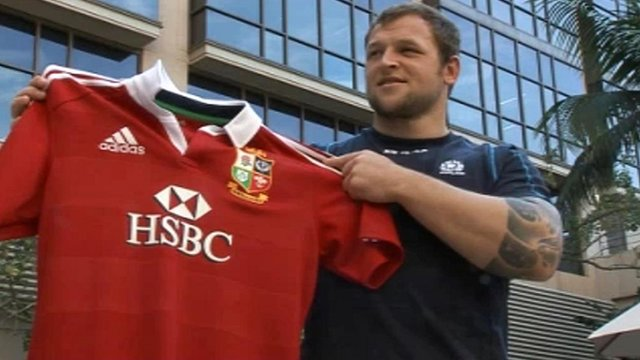 Scotland prop Ryan Grant poses with a Lions jersey on his call-up