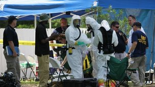 Members of an FBI hazardous materials team prepare to enter the residence in New Boston, Texas, on 31 May 2013