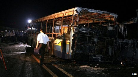 Investigators examine bus in city of Xiamen. 7 June 2013