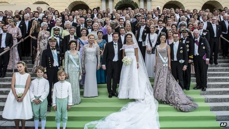 The newlyweds pose for photos with royal families and guests on 8 June