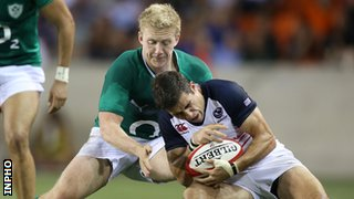 Stuart Olding tackles USA's Mike Petri