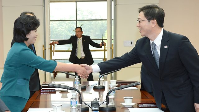 Delegates from North and South Korea shake hands in Panmunjom