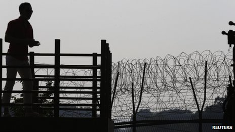 South Korean man looks at military fence in truce village of Panmunjom