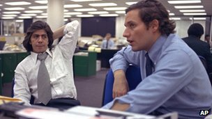 Reporters Bob Woodward (R) and Carl Bernstein (L) sit in the newsroom of the Washington Post in 1973