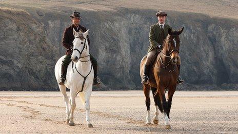Dominic Cooper as AJ Munnings and Dan Stevens as Gilbert Evans in Summer in February