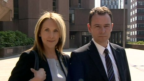 Andrew Watkinson posed for photographs with his wife Louise outside court