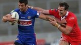 Salford's Matty Ashurst attempts to halt Richie Mathers on the burst