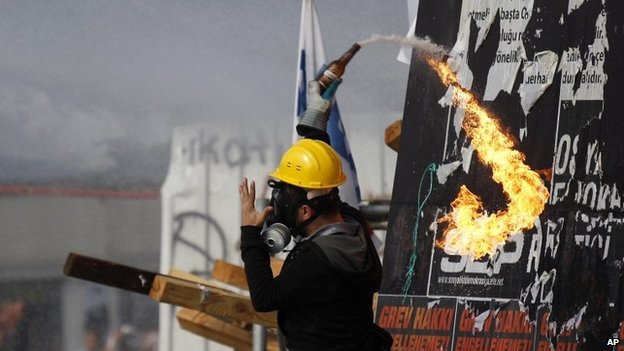 Protester with petrol bomb, Taksim Square 11/6/13