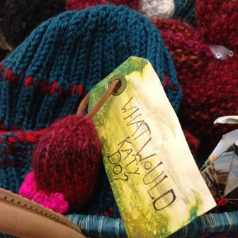 A wicker basket containing Kathryn's knitted hats
