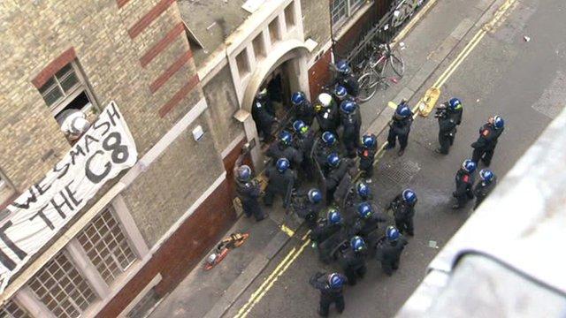 Police officers surround building in Beak Street