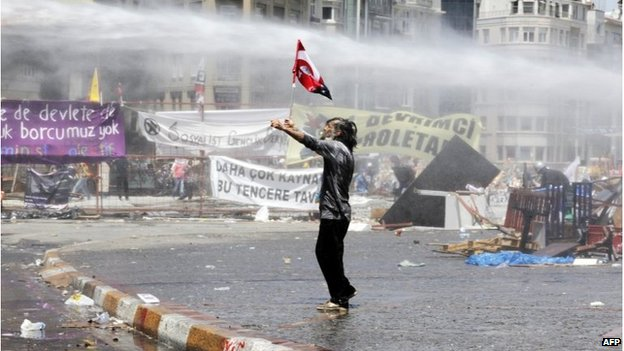 Protester being hit by water cannon in Taksim Square, Istanbul, 11 June 2013