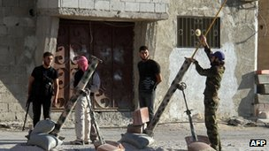 Opposition groups preparing to launch mortar rounds on the outskirts of Damascus