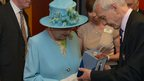 John Humphrys presents the Queen with a digital radio
