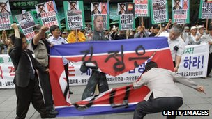 South Korean protesters tear a North Korean flag during an anti-North Korea rally on 12 June 2013 in Seoul, South Korea