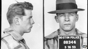 "1953 file Boston police photos provided by The Boston Globe show James ""Whitey"" Bulger after an arrest"