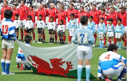 Wales rugby players sing the national anthem before the match with Japan in Osaka
