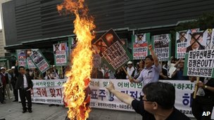 Protesters burn an effigy of North Korean leader Kim Jong-un and during an anti-North Korea rally in Seoul, South Korea, on 12 June 2013