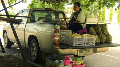 Manee Thongchum selling fruit at the petrol station where Jiji disappeared