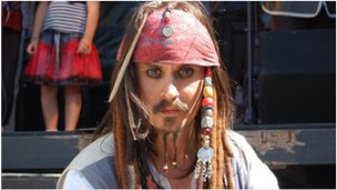 Man dressed as Pirates of the Caribbean character Captain Jack Sparrow