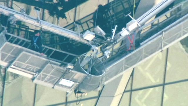 Two men trapped 45 floors above ground