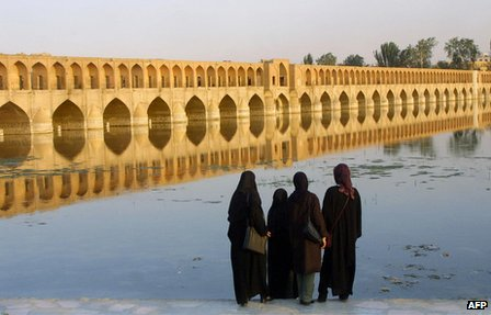 Iranian women look at the Si-o-Se Pol bridge in Isfahan, Iran (13 July 2002).
