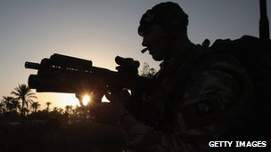 UK soldier takes part in a patrol in Iraq