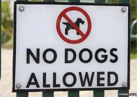 "A ""No dogs allowed"" sign"