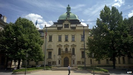 A policeman stands guard in front of the Czech government headquarters on June 13