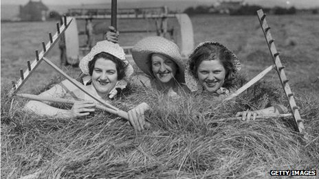 Farm girls in a haystack