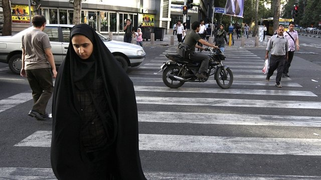 Woman crossing street in Iran