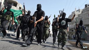 Hamas fighters carry guns and rocket propelled grenades during celebrations on the street in Rafah in June 2007