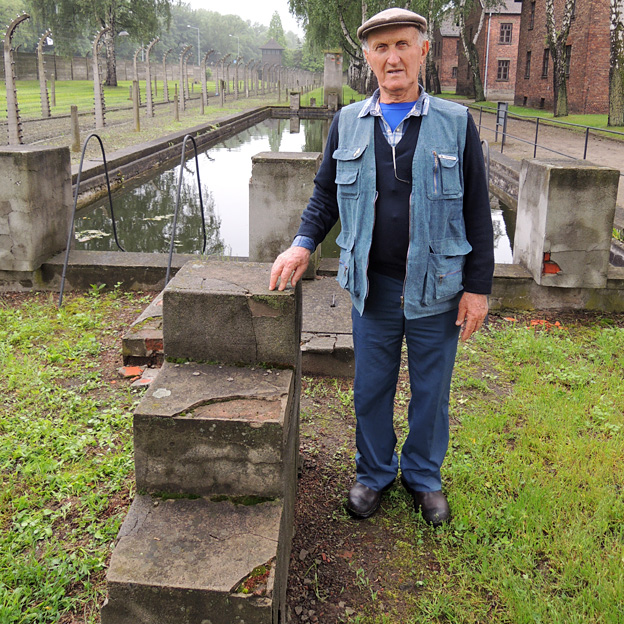 Yechiel Aleksander with the concrete steps he built