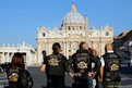Bikers stand in front of St Peter's Basilica