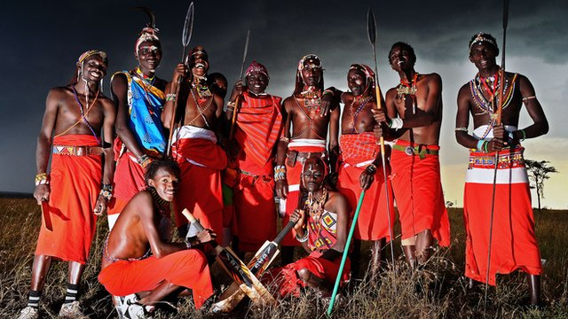 The Maasai Warriors cricket team pose with their bats