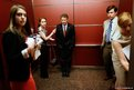 Republican Senator Rand Paul inside in an elevator with reporters and staff members