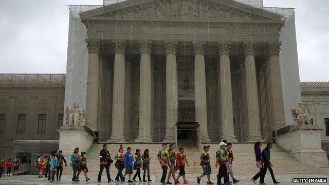 Children walking past Supreme Court