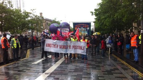 Protest marchers set off from Custom House Square in Belfast