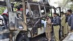 Wreckage of a bus destroyed in a university bomb blast in Quetta, Pakistan, 15 June