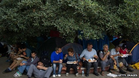 People have lunch under the tree at Taksim Square