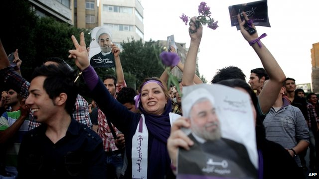 Supporters of Hassan Rouhani celebrate in the streets