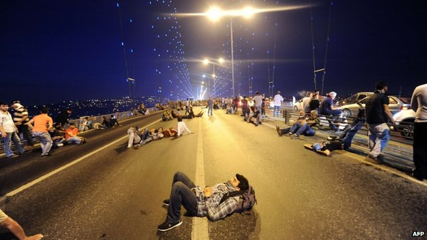 Protesters rest on Istanbul's closed Bosphorous Bridge, early on 16 June