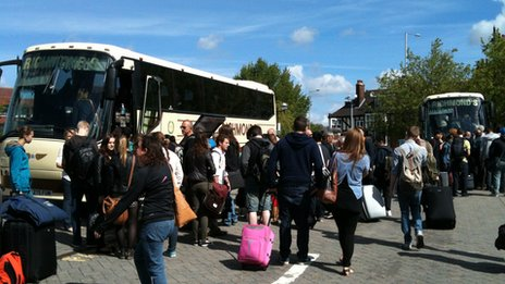 Rail passengers boarding buses at Norwich