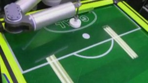 Robot playing air hockey