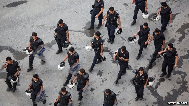 Riot police pass Taksim Square in Istanbul, 16 June