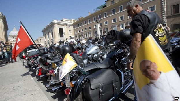 Harley Davison bikes stand parked on St Peter's Square, 16 June