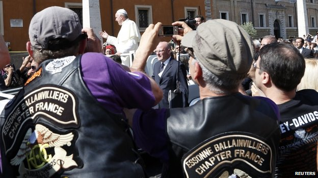 Bikers strain to photograph Pope Francis on St Peter's Square, 16 June