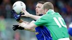 Cavan defender Ronan Flanagan battles for the ball with Erne forward Conor Quigley