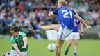 Fermanagh's Eoin Donnelly bravely blocks this shot from Declan McKiernan